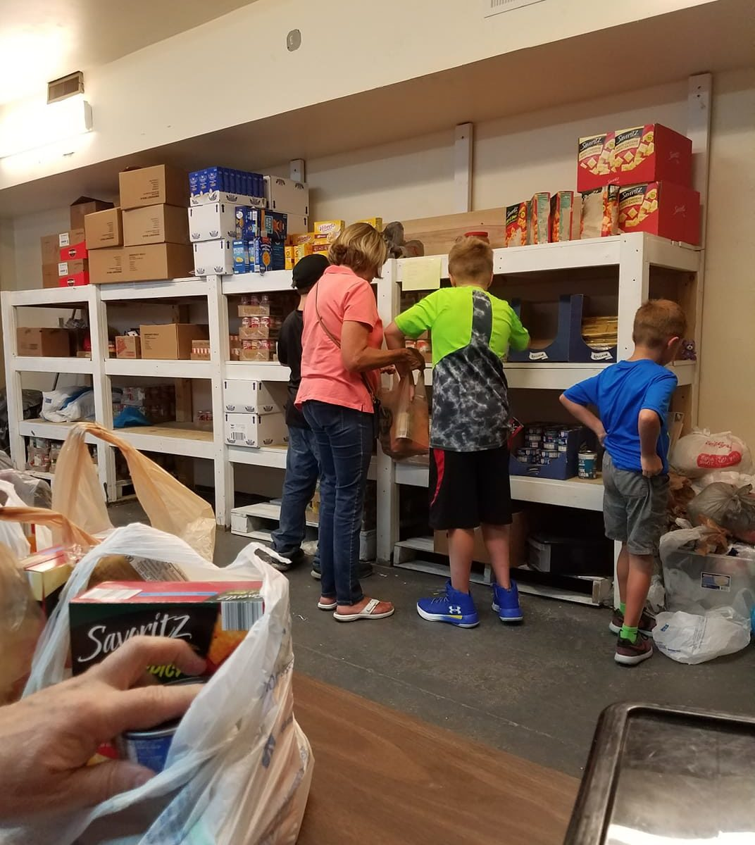 Family standing at the food pantry
